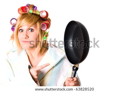 portrait of funny housewife with curlers and pan isolated on white background - stock photo
