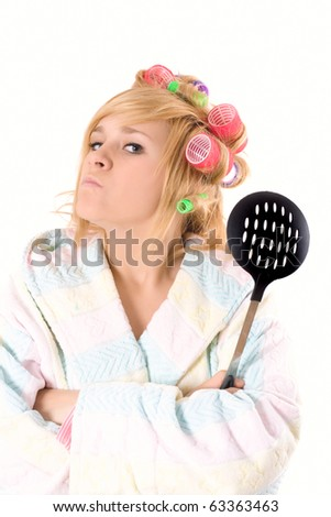 portrait of funny housewife with curlers and skimmer isolated on white background - stock photo