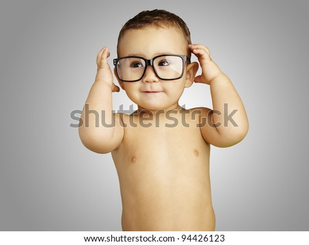 portrait of funny kid shirtless wearing glasses over grey background - stock photo