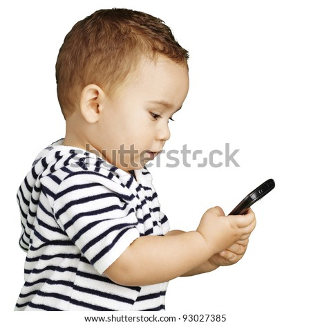 portrait of funny kid touching mobile over white background