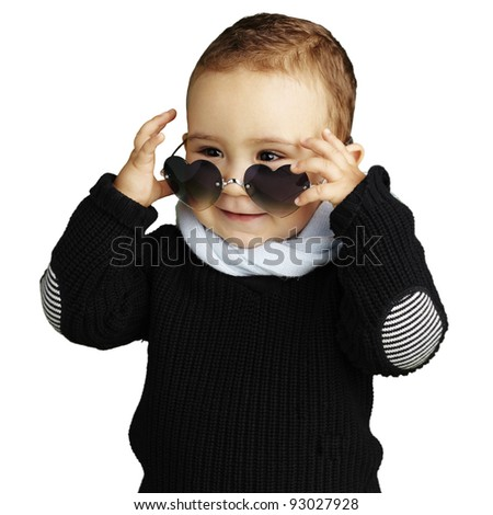 portrait of funny kid wearing heart sunglasses against a white background