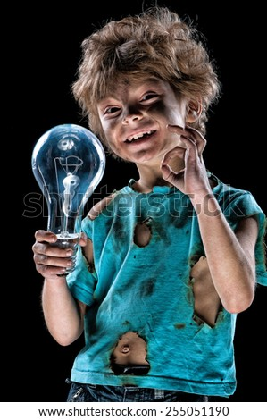 Portrait of funny little electrician over black background - stock photo