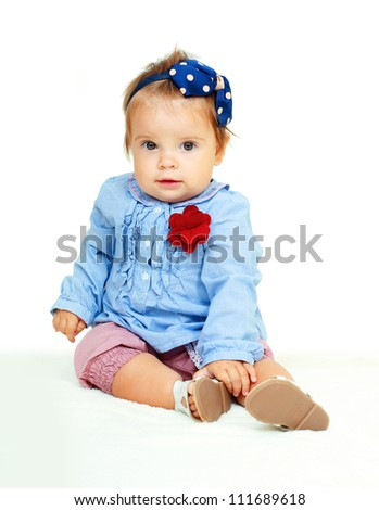 Portrait of funny lovely little  baby girl looking to the camera - stock photo