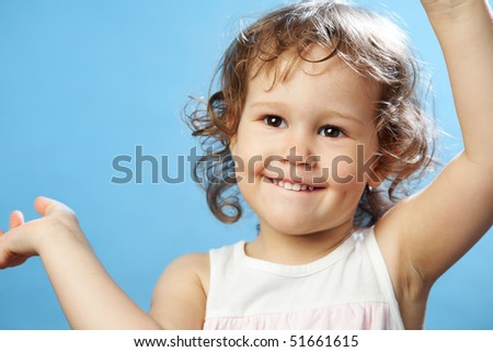 Portrait of funny lovely little girl on the blue background