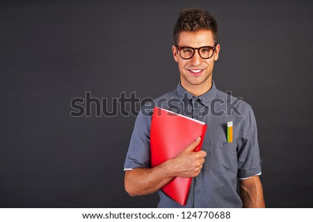 Portrait of funny nerd man with pencls and glasses - stock photo
