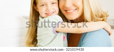 Portrait of funny smiling little girl with mother - stock photo