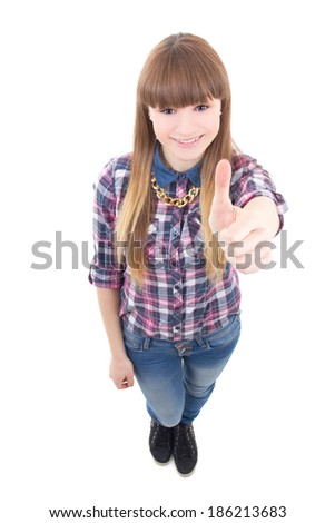 portrait of funny teenage girl thumbs up isolated on white background