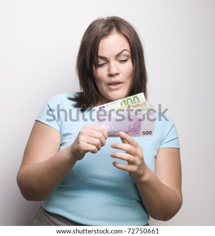 portrait of funny young woman with money, planning shopping