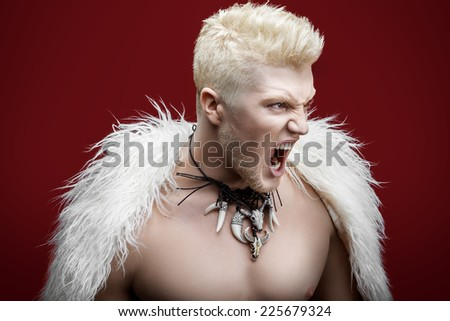 Portrait of furious man on a red background - stock photo