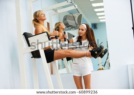 portrait of girl and her trainer working out on VKR