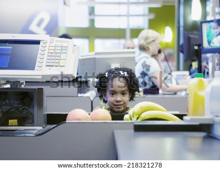 Portrait of girl at checkout line - stock photo