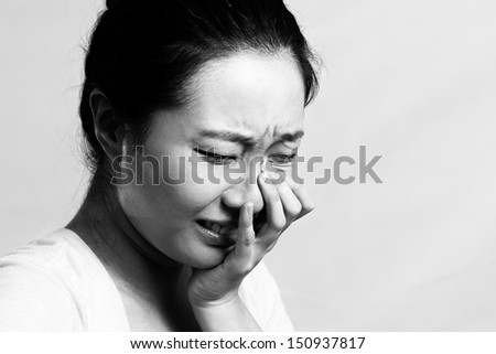 Portrait of girl crying desperately