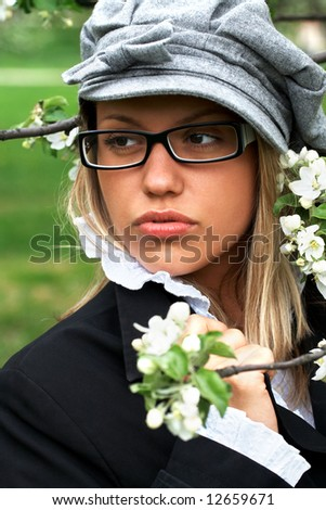 portrait of girl holding apple tre branch with white flowers; shallow DOF