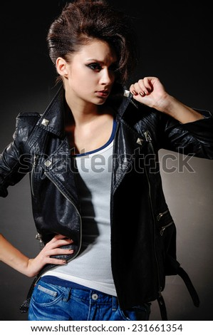 Portrait of girl in jeans, posing isolated  - stock photo