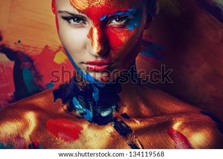 portrait of girl in paints - stock photo