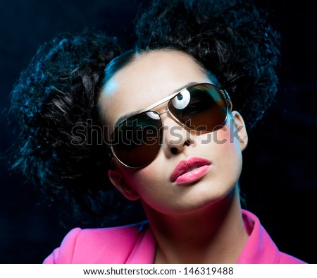 Portrait of girl in the sunglasses on the black background - stock photo