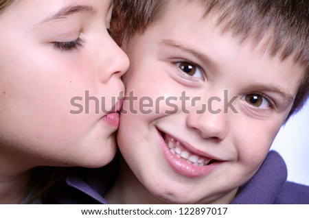 portrait of girl kissing boy
