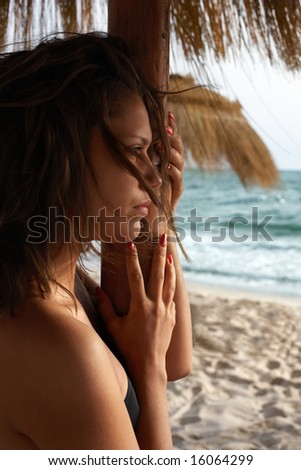 portrait of girl on beach; sea on background