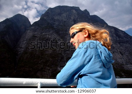 portrait of girl on ferry in Norway - stock photo