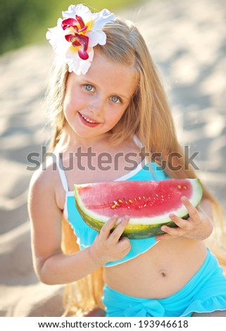 portrait of girl on the beach in summer - stock photo