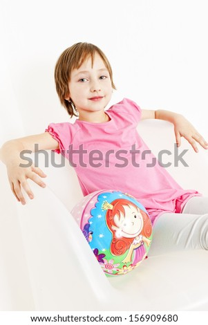 portrait of girl sitting with a ball - stock photo