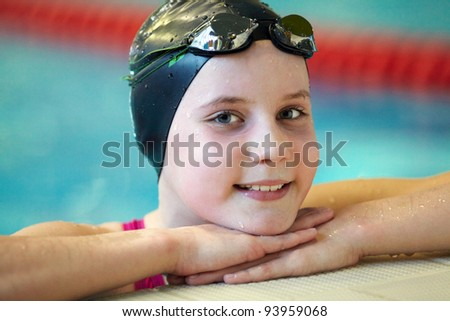 Portrait of girl swimmer in swimming pool