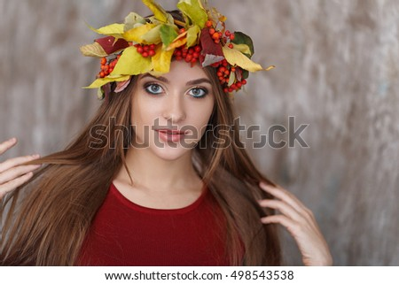 Portrait of girl with autumn wreath
