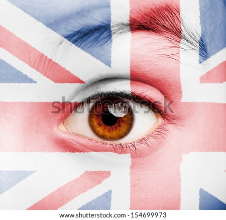 portrait of girl with british flag painted on her face