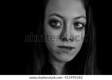Portrait of girl with bruised face because of domestic violence