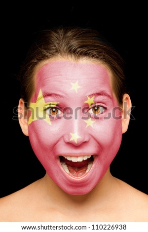portrait of girl with chinese flag on her face - stock photo