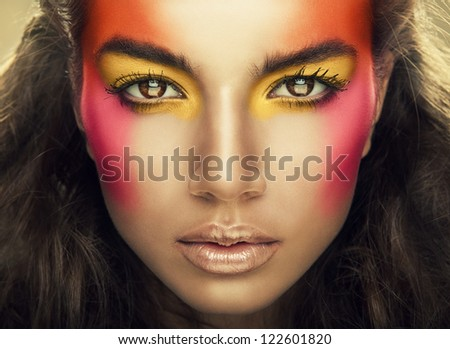 portrait of girl with eye shadows on face - stock photo
