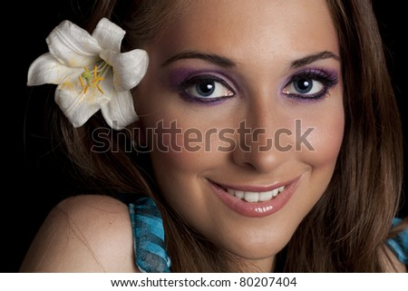 Portrait of girl with flower in hair