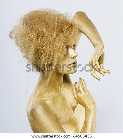 portrait of girl with golden bodyart on gray