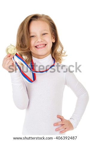 Portrait of girl with golden medal on a gray background