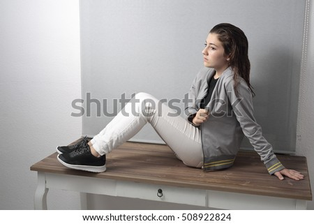 Portrait of girl with light of study in your room. Horizontal shooting