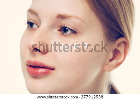Portrait of girl woman with problem and clear skin creme, aging and youth concept  touching face with cream - stock photo