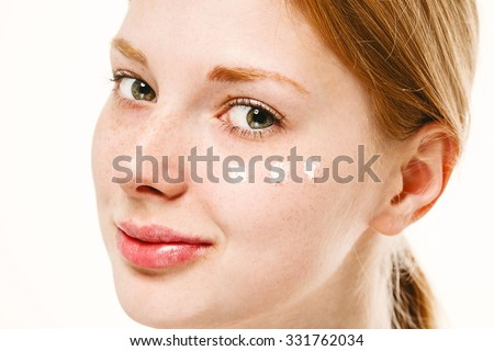 Portrait of girl woman with problem and clear skin creme, aging and youth concept  touching face with cream