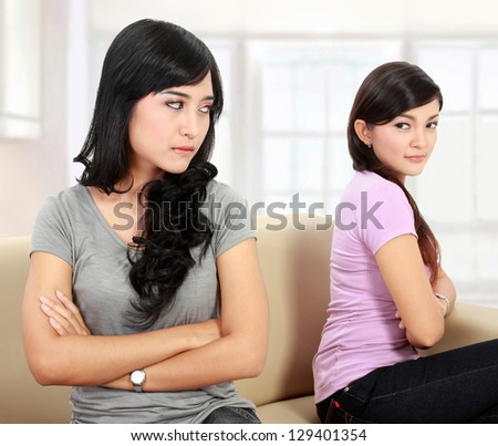 portrait of girls hate each other - stock photo