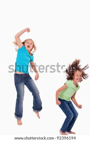 Portrait of girls jumping against a white background - stock photo