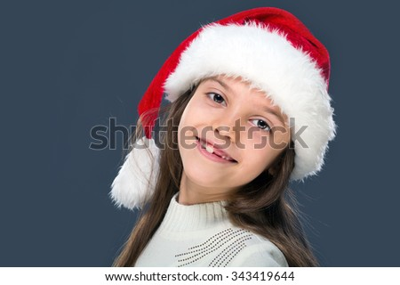 Portrait of girls of primary school age in the Christmas hat - stock photo