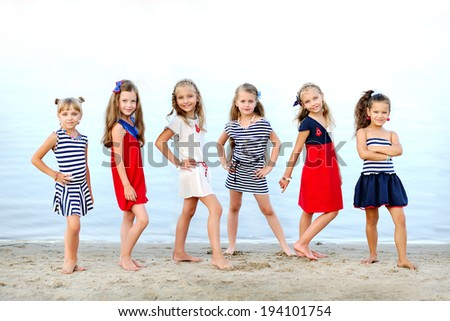 Portrait of girls on the beach - stock photo