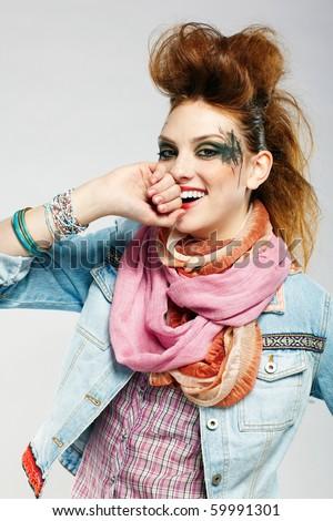 portrait of glam punk redhead girl posing on gray - stock photo