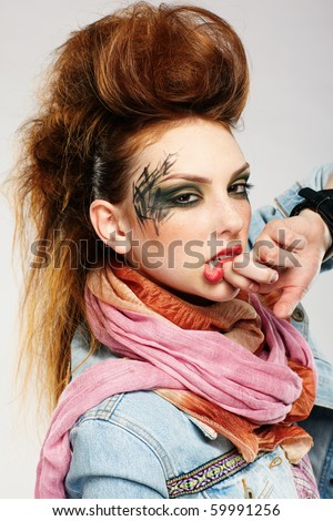 portrait of glam punk redhead girl wiping her lips - stock photo