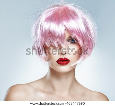 Portrait of glamour girl with red lips and pink hair isolated on blue background - stock photo