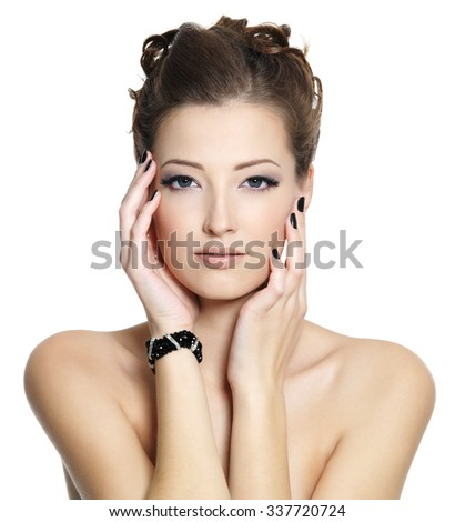Portrait of  glamour sexy young woman with black nails and  eye make-up, posing on white background