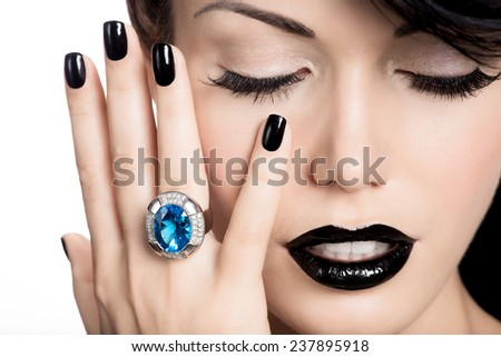 Portrait of glamour woman's nails , lips and eyes painted color black.  Girl with fashion  bright makeup. - stock photo
