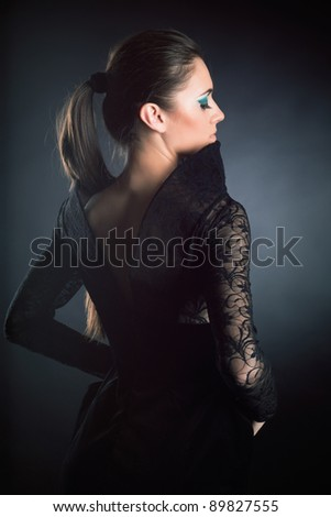 portrait of glamour young girl in black dress with beautiful make-up