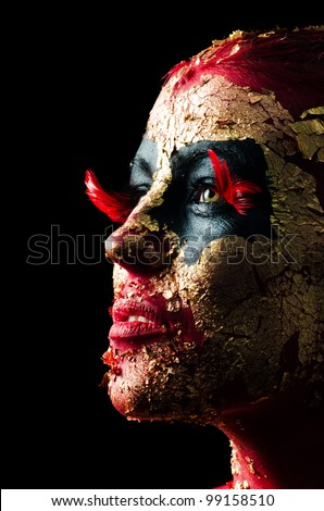 Portrait of golden and red fire demon girl - stock photo