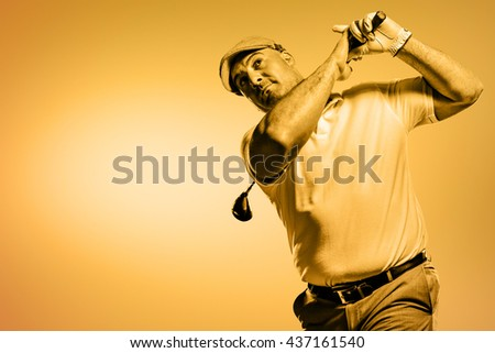 Portrait of golf player taking a shot against orange background