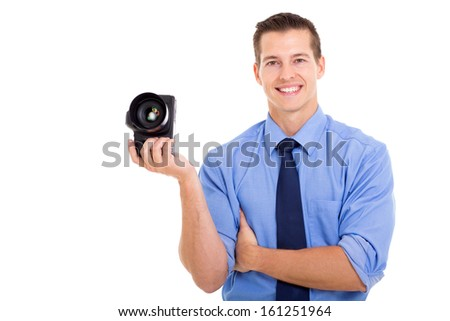 portrait of good looking male photographer holding camera - stock photo